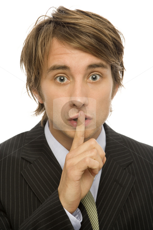 Businessman wispers stock photo, Businessman in suit gestures to be quiet with his finger by Rick Becker-Leckrone