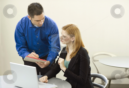 Business people talk and use laptop stock photo, Two business people talk and use a laptop by Rick Becker-Leckrone