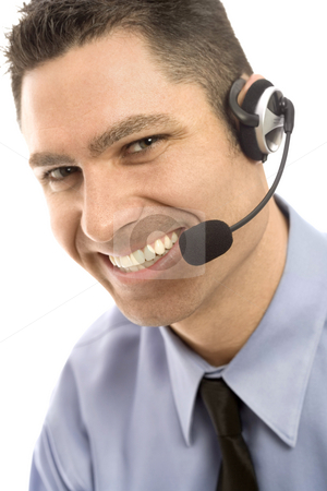 Businessman with headset stock photo, Businessman smiles as he uses a headset by Rick Becker-Leckrone