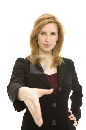 Businesswoman handshake stock photo, Businesswoman in a suit gestures a hand shake seriously by Rick Becker-Leckrone