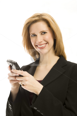 Businesswoman with mobile device stock photo, Businesswoman texts on a mobile device and smiles by Rick Becker-Leckrone