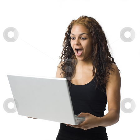 Surprised girl with laptop stock photo,  by Rick Becker-Leckrone