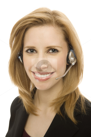 Businesswoman uses headset stock photo, Businesswoman in a suit happily uses a headset by Rick Becker-Leckrone