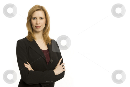 Businesswoman stands with confidence stock photo, Businesswoman stands with her arms crossed by Rick Becker-Leckrone