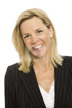 Blonde businesswoman smiles stock photo, Blonde businesswoman in a suit smiles against a white background by Rick Becker-Leckrone