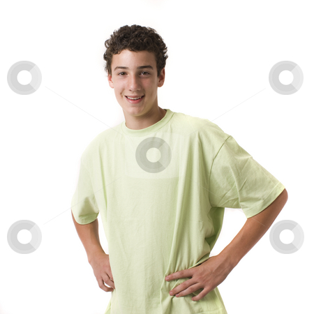 Boy in studio smiles stock photo, A boy in a green shirt smiles by Rick Becker-Leckrone