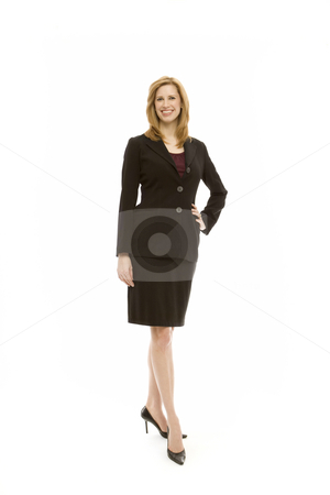 Businesswoman stands with confidence stock photo, Businesswoman in a suit stands with confidence in a studio by Rick Becker-Leckrone