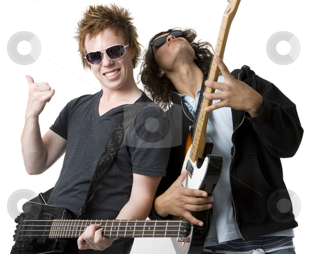 Two guys rock out stock photo, Two guys rock out with guitars by Rick Becker-Leckrone