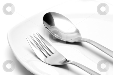 Fork and spoon on a plate stock photo, Fork and spoon on a plate by Andrey Butenko