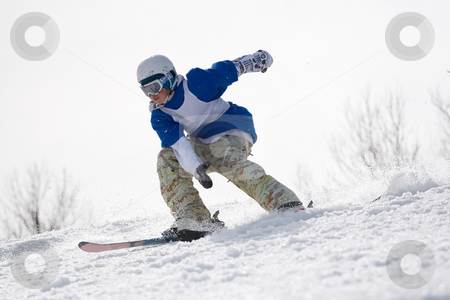 Extreme Skier  stock photo, A skier carving through the snow as he speeds down the mountain approaching a jump. by Todd Arena