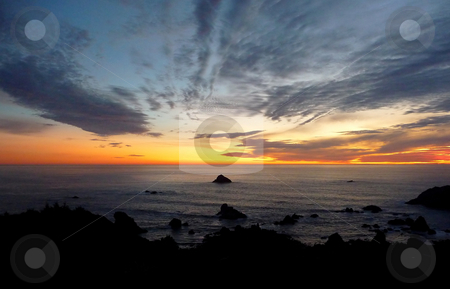 Dramatic sunset on the Oregon coast 925A stock photo, Dramatic and colorful sunset along the rocky Oregon coast by Jill Reid
