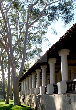 Spanish mission stock photo, Architectural columns and trees of spanish mission by Jill Reid
