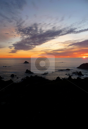 Dramatic sunset on the Oregon coast 920A stock photo, Dramatic and colorful sunset along the rocky Oregon coast by Jill Reid