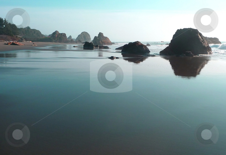 Turqoise water reflections stock photo, Sky reflects a turqoise hue on the sand of a rocky beach in Oregon by Jill Reid