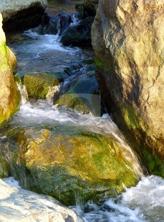 Close-up of water rushing over rocks stock photo, Close-up of water rushing and cascading over rocks by Jill Reid