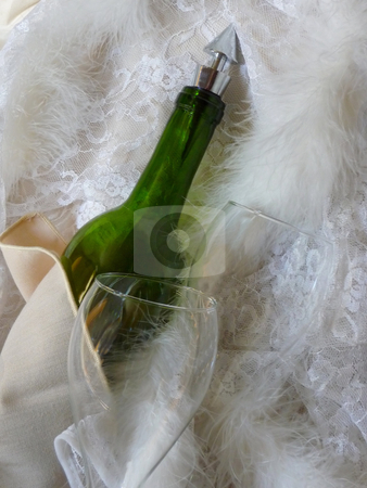 Wine bottle and crystal glasses stock photo, Romantic celebration with wine bottle and crystal glasses by Jill Reid