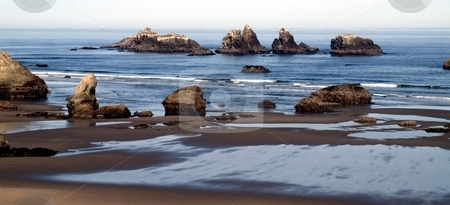 Bandon Beach Oregon stock photo, View of the rocky coast and shore at Bandon Beach, Oregon by Jill Reid
