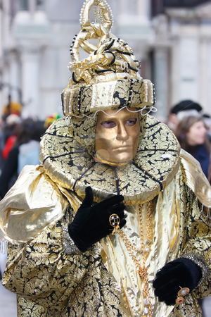 Golgen carnival dress stock photo, Venetian golden mask on Mardi Grass by Natalia Macheda
