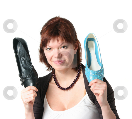 Problem of choice stock photo, Young woman deciding of which shoes to put on by Natalia Macheda
