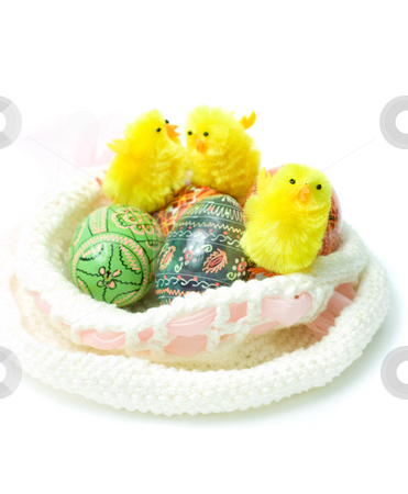 Easter theme stock photo, Easter colorful eggs and funny toy chickens in nest-bonnet by Natalia Macheda