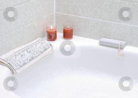Bubble Bath with Candles stock photo, Bubble bath with lit burning candles and pumice stone by John Teeter