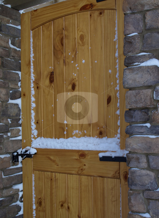 Close view of wooden door and stone entry stock photo, Solid wooden security door in stone entry by Jill Reid