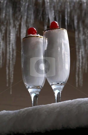 Crystal glasses of snow with cherry stock photo, Crystal stemware filled with snow and a cherry on top by Jill Reid