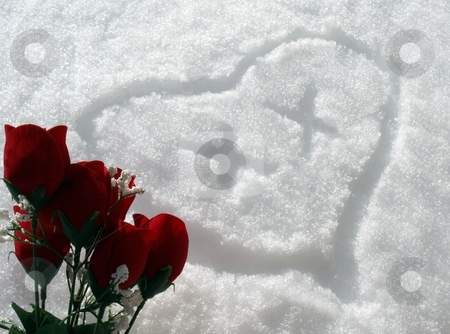 Snow heart with red roses and x's  stock photo, A heart drawn in the snow with red rose bouquet and x's by Jill Reid
