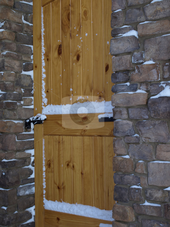 Wooden door and stone entry stock photo, Solid wooden security door in stone entry by Jill Reid