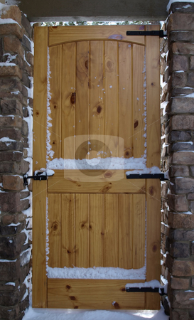 Full size wooden door and stone entry stock photo, Solid wooden security door in stone entry by Jill Reid