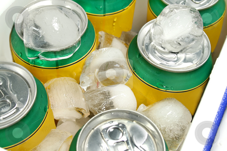 Drinks Cooler stock photo, Icy cold cans of drinks in a plastic cooler. by Brett Mulcahy