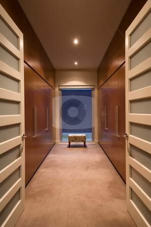 Walk in wardrobe stock photo, A spacious luxury walk in wardrobe featuring modern style joinery by Angus Benham