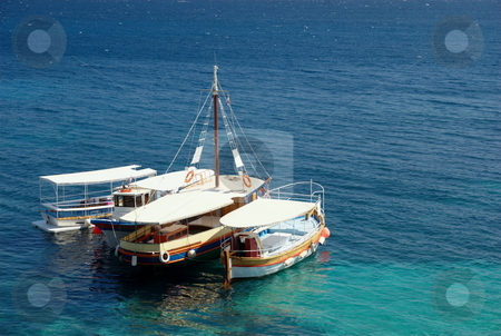 Taxi boats stock photo, Tourist taxi boats on mediterranean sea - beach