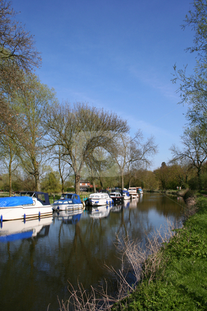 Boats along the Canal Bank stock photo, Various types of boats moored along a canal bank in Spring by Helen Shorey