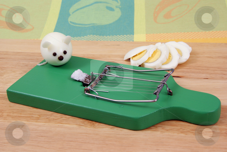 Egg cutter stock photo, Egg cutter as mousetrap and egg-mouse as background by Jolanta Dabrowska