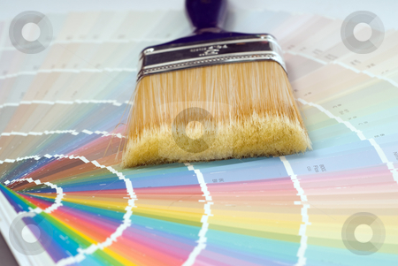 Paint Selection stock photo, Closeup view of a paint brush lying on some colored swatches by Richard Nelson