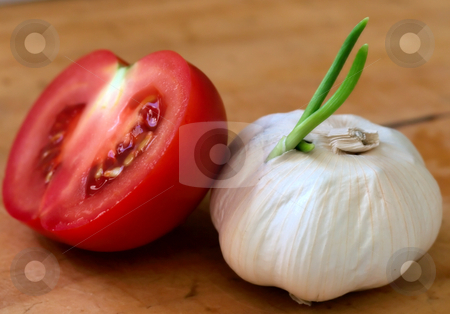 Garlic and Half Tomato stock photo, Still-life of garlic head by Luke Fabish