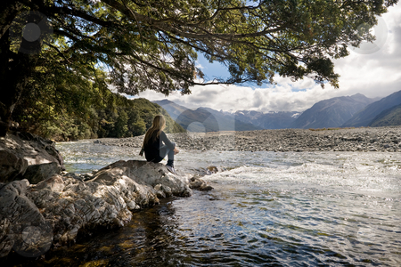 Revitalize the mind stock photo, A girl sits and day dreams at a mountain stream by Angus Benham