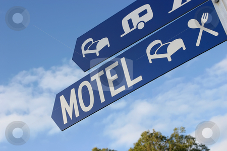 Motel signs stock photo, A blue street sign shows the way to accommodation by Angus Benham