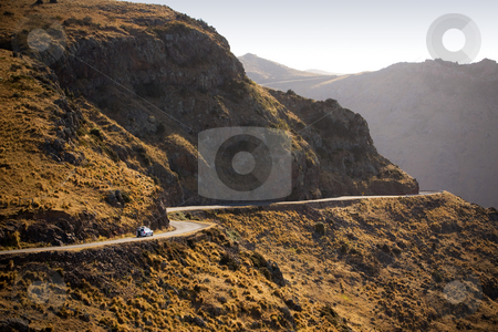 Drive far away stock photo, A car on a twisty mountain road by Angus Benham