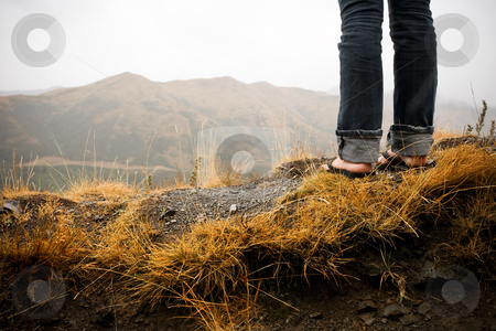 Get motivated stock photo, A girl stands with a view from a steep vantage point by Angus Benham