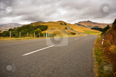Country road stock photo, A country road twists through farmland by Angus Benham