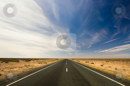 Endless journey stock photo, A road stretches for eternity by Angus Benham