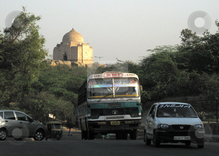 Bus and Tomb stock photo, A view of New Delhi: a CNG bus, with an old tomb behind. by Colin Elves