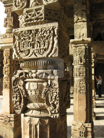 Carved Mughal Pillars stock photo, Some details of the carving on the Pillars of the ruined Mosque by the Qutub Minar in Delhi by Colin Elves