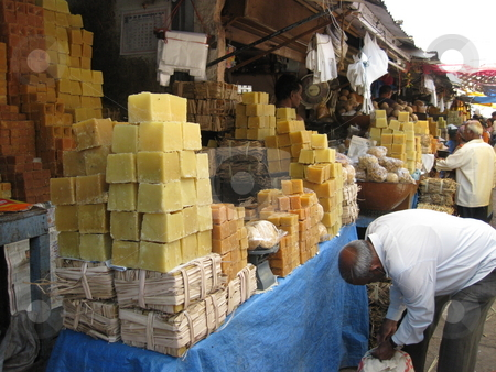 Jaggery Stall stock photo, A market stall selling unrefined cane sugar - jaggery by Colin Elves
