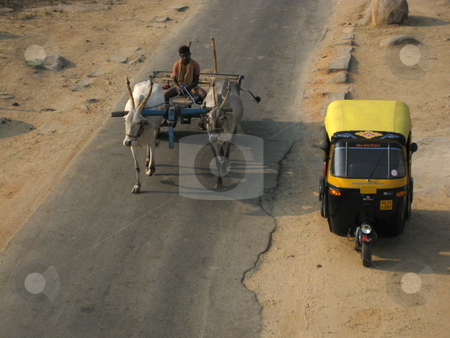 Auto and Cow Cart stock photo, An auto rickshaw next to a buffalo drawn cart, India. by Colin Elves