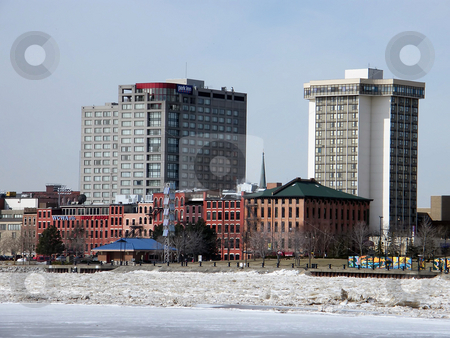 Toledo's Frozen Riverfront  stock photo, Frozen Riverfront, A few of the Buildings in Toledo Ohio which set near the shores of the Maumee River. Photo taken in mid winter when almost everything was frozen and covered in snow. by Dazz Lee Photography