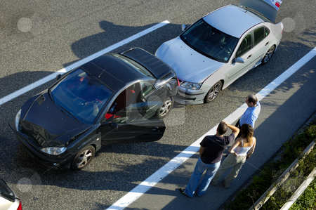 Fender Bender4 stock photo, Three people stand by the roadside, discussing what has happened after a small shunt on the freeway (motorway, autoroute, autobahn). by Alistair Scott