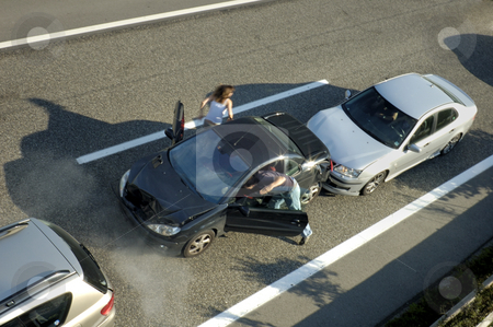 Fender Bender stock photo, A small shunt on the freeway (motorway, autoroute, autobahn) a few seconds after it happened. Steam can be seen coming from under the bonnet of the black car. Motion blur on the passenger fleeing in panic. by Alistair Scott